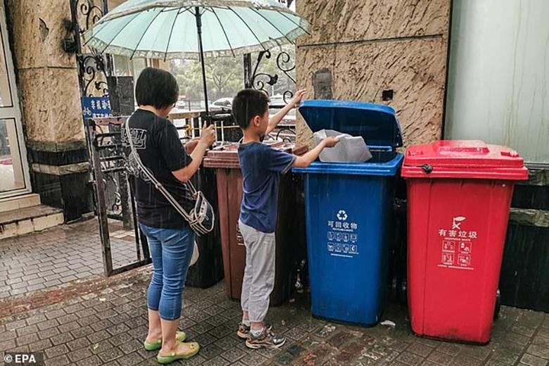 استفاده چینی ها از اپلیکیشن مجهز به هوش مصنوعی برای تفکیک زباله ها به دنبال اعمال قانون سخت گیرانه در شانگهای
